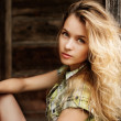 Стоковое фото: Portrait of Blonde Womat Wooden Background