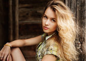 Portrait of Blonde Woman at the Wooden Background — Стоковое фото