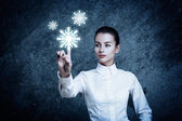 Woman Pointing at Glowing Snow Icon — Stock Photo