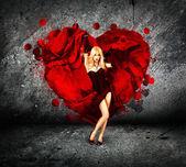 Woman with Splashing Heart on Dark Background — Stock Photo