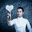 Woman Pointing at Glowing Digital Heart — Stock Photo