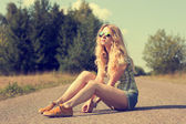 Trendy Hipster Girl Sitting on the Road — Stock Photo