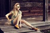 Trendy Hipster Girl Sitting on the Wooden Porch — Stock fotografie