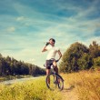 Man Riding a Bicycle on Nature Background — Stock Photo