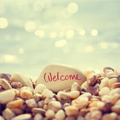 """Welcome"" Text Written on the Stone at Beach — Stockfoto"