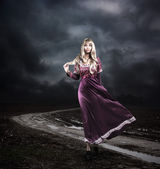 Woman in Purple Dress Walking on Dirty Road — Foto Stock