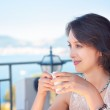 Young Woman Drinking Coffee at Cafe Terrace — Stock Photo #47393797