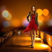 Woman in Red Dress Walking in Night City — Stock Photo