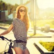 Trendy Hipster Girl with Bike in the City — Stock Photo #50588179