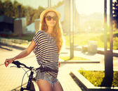 Trendy Hipster Girl with Bike in the City — Stock Photo
