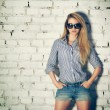 Portrait of Young Hipster Woman at the Brick Wall — Stock Photo #50903491