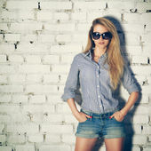Portrait of Young Hipster Woman at the Brick Wall — Stock Photo