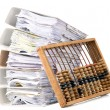 Mathematical calculator abacus with papers - Stock Photo