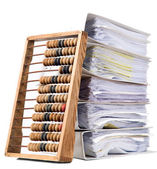 Mathematical calculator abacus with papers — Stock Photo