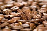 Fundo marrom de grãos de café — Fotografia Stock