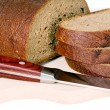 Stockfoto: Dark bread with some sliced pieces