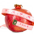 Tasteful fruit garnet with measuring tape — Stock Photo #36527963