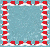 Christmas frame with snow and caps — Zdjęcie stockowe