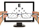 Man is viewing to eye examination chart — Foto Stock