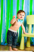 Child is standing near chair — Stock Photo