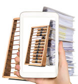 Man is taking photo of many documents — Stock Photo