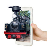 Old vintage train throug screen of mobile phone — Stock Photo