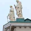 Stock Photo: Statues of saints on roof.