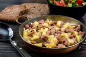 Fried potato with meat — Stock Photo