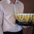 Waiter with champagne — Stock Photo