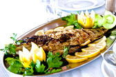 Fried fish on a platter — Stock Photo