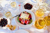 Greek salad with white wine — Stock Photo