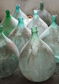 Old italian demijohn — Stock Photo
