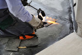 Man applying waterproof coating — Stock Photo