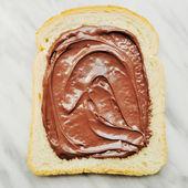 Bread with chocolate cream — Stock Photo