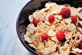Cornflakes with little strawberries — Stock Photo