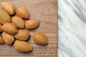 Almonds on wooden top — Stock Photo