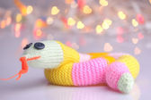 Happy cute knitted snake — Stock Photo