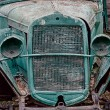 Old abandoned rusted truck with empty headlamps — Stock Photo