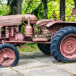 Stock Photo: Old abandoned rusting soviet caterpillar tractor