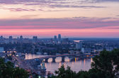The view of the Dnieper river and bridge in Kyiv at sunset — Stok fotoğraf