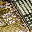 Electronic components on a obsolete printed-circuit board — Stockfoto