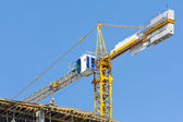 Crane on construction site over blue sky — Stock Photo