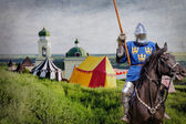 Armored knight on warhorse over old medieval castle — Stock Photo