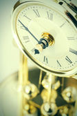 Period clock with oscillating mechanism — Stock Photo