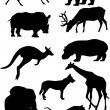 Silhouettes of mammal — Stock Vector #34335193