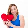 Woman holding a red heart — Stock Photo #10115325