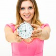 Woman holding a clock — Stock Photo #13800146