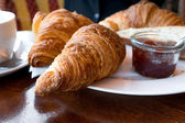 Coffee and croissants — Stok fotoğraf
