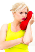 Sad woman holding red valentine heart — Stock Photo