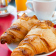 Coffee and croissants - Stock Photo